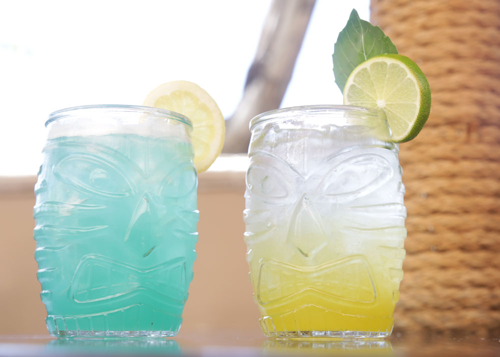 Photography of balboa pizza mixed drinks in tiki cups
